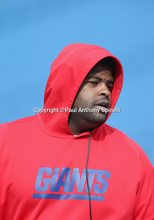 New York Giants defensive tackle Johnathan Hankins (95) looks on with a red hoodie sweatshirt on a blue background during the 2015 NFL week 4 regular season football game against the Buffalo Bills on Sunday, Oct. 4, 2015 in Orchard Park, N.Y. The Giants won the game 24-10. (©Paul Anthony Spinelli)