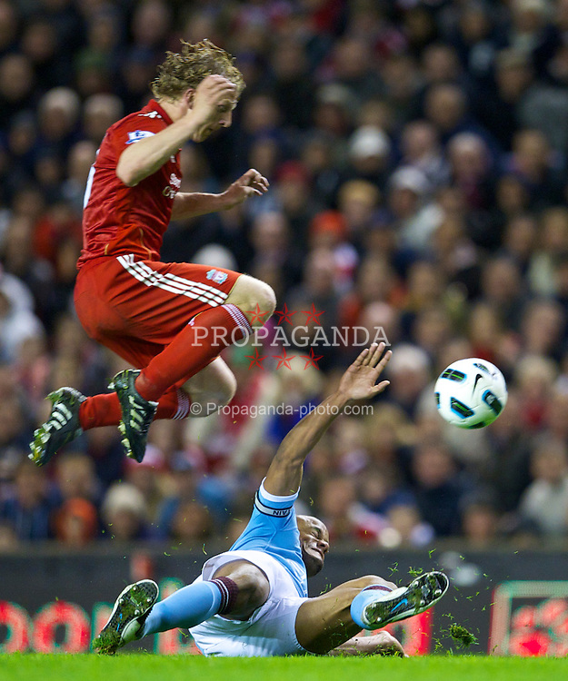 LIVERPOOL, ENGLAND - Monday, April 11, 2011: Liverpool's Dirk Kuyt and Manchester City's Vincent Kompany during the Premiership match at Anfield. (Photo by David Rawcliffe/Propaganda)