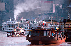CHINA SICHUAN PROVINCE WANXIAN MAY99 - Ferries clog up the port at Wan Xian on the shores of the Yangtse river. Seven large cities, including Chongquing, and thousands of villages will be submerged once the water level rises after the completion of the controversial Three Gorges Dam project further downriver. The flooding of areas reaching back more than 550Km upriver will require the evacuation and resettlement of more than 10 million people.  jre/Photo by Jiri Rezac. © Jiri Rezac 1999. . Contact: +44 (0) 7050 110 417. Mobile:  +44 (0) 7801 337 683. Office:  +44 (0) 20 8968 9635. . Email:   jiri@jirirezac.com. Web:     www.jirirezac.com