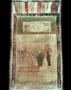 Stele of Imenyseneb (2123-2040 BC), Egyptian painted limestone section from a Stella (stele). Imenyseneb is served by his wife under the protective symbol of the Wedjet eye. Imenyseneb was chief of expeditions for the royal court of the Pharaoh.