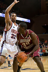Boston College forward Shamari Spears (34) is guarded by Virginia forward Mike Scott (32).  The Virginia Cavaliers men's basketball team faced the Boston College Golden Eagles at the John Paul Jones Arena in Charlottesville, VA on January 19, 2008.