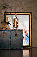 Fine art photograph.  Reflection of the photographer in an antiques shop window in Venice, Italy.