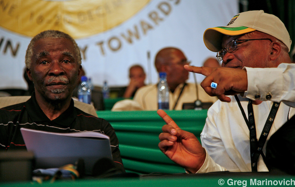 POLOKWANE, SOUTH AFRICA DEC 16, 2007: Jacon Zuma (rights) speaks to President Thabo Mbeki after Mbeki's two-and-a-half hour speech at the conference to choose a new National Executive Committee - and the two presidential candidates - President Thabo Mbeki and Deputy President Jacob Zuma -   of the ruling African National Congress (ANC) campaign in Polokwane, Limpopo province, South Africa. Photo Greg Marinovich