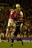 Photo. Greig Cowie<br />Arsenal v Roma. UEFA Champions League. 11/03/2003<br />Pascal Cygan and Gilberto challenge Vincenzo Montella of Roma for the ball