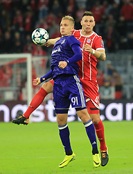 MUNICH, Sept. 13, 2017  Bayern Munich's Niklas Suele (R) vies with Anderlecht's Lukasz Teodorczyk during the first round of UEFA Champions League (UCL) group match between Bayern Munich of Germany and RSC Anderlecht of Belgium, in Munich, Germany, on Sept. 12, 2017. Bayern Munich won 3-0. (Credit Image: © Philippe Ruiz/Xinhua via ZUMA Wire)