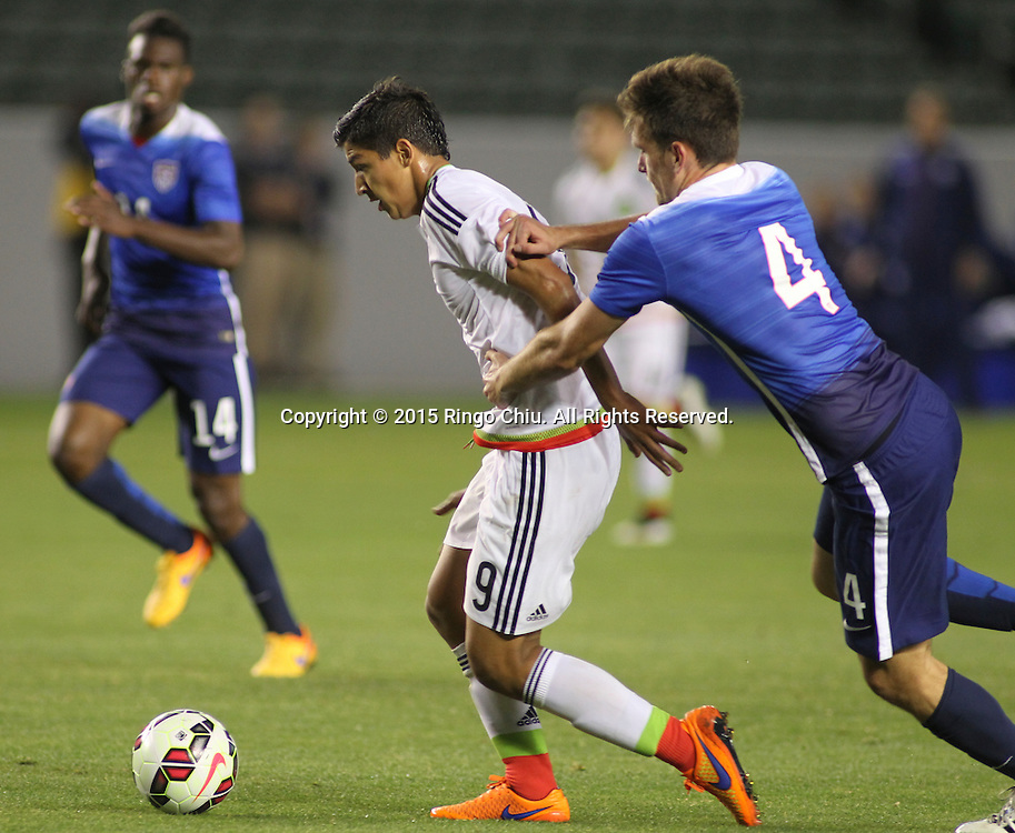 United States' Shane O'Neill #4 actions against Mexico's §ngel Zaldivar #9 during a men's national team international friendly match, April 22, 2015, at StubHub Center in Carson, California. United States won 3-0. (Photo by Ringo Chiu/PHOTOFORMULA.com)