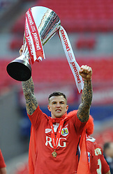 Bristol City's Aden Flint celebrates with the cup after winning the Johnstone Paint Trophy - Photo mandatory by-line: Dougie Allward/JMP - Mobile: 07966 386802 - 22/03/2015 - SPORT - Football - London - Wembley Stadium - Bristol City v Walsall - Johnstone Paint Trophy Final