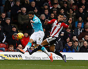 Derby County Defender Cyrus Christie gets a cross in for Derby County forward Darren Bent to attack during the Sky Bet Championship match between Brentford and Derby County at Griffin Park, London, England on 20 February 2016. Photo by Andy Walter.