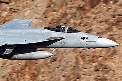 United States Navy Boeing F/A-18E Super Hornet (NJ 222) from the VFA-122 Flying Eagles squadron flies low level on the Jedi Transition through Star Wars Canyon / Rainbow Canyon, Death Valley National Park, Panamint Springs, California, United States of America