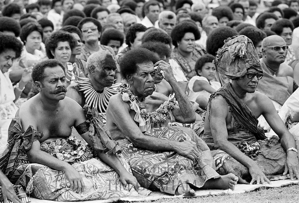 Locals attending traditional native kava ceremony at tribal gathering in Fiji, South Pacific