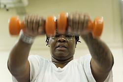 Nashikia 'Shik' Hanton lifts weights as part of the exercise program