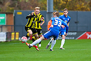 Burton Albion forward Mark Duffy skips the ball past Peterborough United midfielder Chris Forrester during the The FA Cup match between Burton Albion and Peterborough United at the Pirelli Stadium, Burton upon Trent, England on 7 November 2015. Photo by Aaron Lupton.