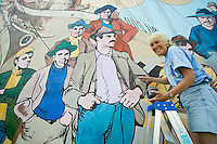 Mural projects in the picturesque town of Chemanius on Southern Vancouver Island, dot the downtown core.  Artisans can be seen maintaining the murals throughout the summer months.  Chemanius, Vancouver Island, British Columbia, Canada.