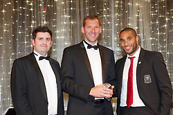 CARDIFF, WALES - Monday, October 8, 2012: Aberystwyth Town's Aneurin Thomas receives the Welsh Premier League Clubman of the Year award from Wales' captain Ashley Williams [r] and HSBC's Jonathan Bridgeman during the FAW Player of the Year Awards Dinner at the National Museum Cardiff. (Pic by David Rawcliffe/Propaganda)