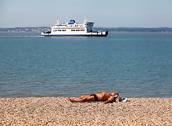 © Licensed to London News Pictures. 16/05/2014. Southsea, Hampshire, UK. A man sunbathing in the sunshine on the beach at Southsea, Hampshire this morning, 16th May 2014. Photo credit : Rob Arnold/LNP