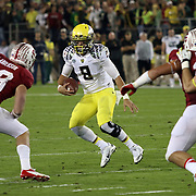 Marcus Mariota scrambles in the 4th Quarter vs a resilient Stanford Defense.  The Stanford Cardinals upset the Oregon Ducks 26-20 at Stanford Stadium.  11/7/13, 3:30pm, Photo by Barry Markowitz