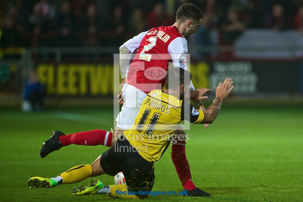 Dale Jennings of Barnsley is fouled by Conor McLaughlin of Fleetwood Town during the Sky Bet League 1 match at the Highbury Stadium, Fleetwood<br /> Picture by Ian Wadkins/Focus Images Ltd +44 7877 568959<br /> 17/09/2014