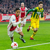 AMSTERDAM - Ajax - ADO , Voetbal , Eredivisie , Seizoen 2016/2017 , Amsterdam ArenA , 29-01-2017 ,  Ajax speler Justin Kluivert (l) passeert ADO Den Haag speler Danny Bakker (r) eenvoudig