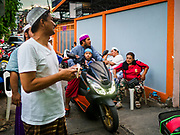 16 MAY 2018 - BANGKOK, THAILAND: Men arrive at Masjid (Mosque) Darul Falah,  a small mosque in Baankrua, the oldest Muslim neighborhood in Bangkok, for evening prayers to start on the first night of Ramadan. Based on the sighting of the new moon, Ramadan fasting starts on Thursday, 17 May in Thailand.      PHOTO BY JACK KURTZ