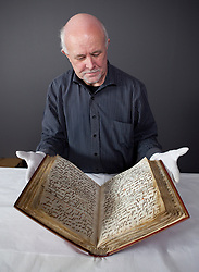 © Licensed to London News Pictures. 13/01/2012. London, U.K...The Installation of one of the oldest known copies of the Qur'an (Ma'il Qur'an), lent by the British Library to the British Museum for the major exhibition, Hajj: journey to the heart of Islam that opens to the public on Thursday 26th January 2012. .Photo credit : Rich Bowen/LNP