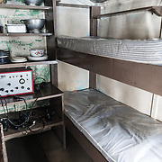 Bunk beds next to the kitchen of Wordie House. Originally known as Base F and later renamed after James Wordie, chief scientist on Ernest Shackleton's major Antarctic expedition, Wordie House dates to the mid-1940s. It was one of a handful of bases built by the British as part of a secret World War II mission codenamed Operation Tabarin. The house is preserved intact and stands near Vernadsky Research Base in the Argentine Islands in Antarctica.