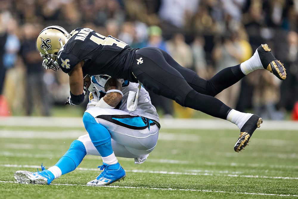 NEW ORLEANS, LA - DECEMBER 8: Roman Harper #41 of the New Orleans Saints tackles Steve Smith #89 of the Carolina Panthers at Mercedes-Benz Superdome on December 8, 2013 in New Orleans, Louisiana.  The Saints defeated the Panthers 31-13.  (Photo by Wesley Hitt/Getty Images) *** Local Caption *** Roman Harper; Steve Smith