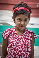 Young Burmese girl at the Shwedagon Pagoda in Yangon, Burma.