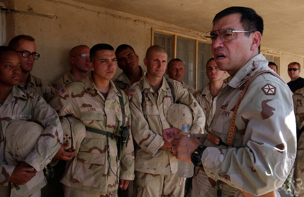 U.S. Army Lieutenant General Ricardo Sanchez (r), Commander of U.S. Ground Forces in Iraq speaks with members of the 4th Infantry Division, 1-66th Armoured Regiment during a brief visit to their Samarra, Iraq base August 13, 2003.