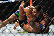 DALLAS, TX - MARCH 14:  Rafael Dos Anjos (top) grapples with Anthony Pettis during UFC 185 at the American Airlines Center on March 14, 2015 in Dallas, Texas. (Photo by Cooper Neill/Zuffa LLC/Zuffa LLC via Getty Images) *** Local Caption *** Rafael Dos Anjos; Anthony Pettis