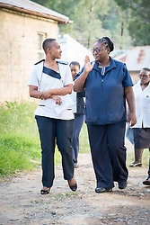 "2 March 2017, Morija, Maseru district, Lesotho: Gwendolyn (right) and Malika (left) are nurses at Scott Hospital, where they've worked for 10 and 8 years, respectively. Both studied at Maluti Adventist Hospital. Scott Hospital is run by the Lesotho Evangelical Church in Southern Africa and is a founding member of the Christian Health Association of Lesotho. It is located in the village of Morija, and operates and supervises clinics in the Maseru District of Lesotho. Scott started out as a dispensary in 1864, and today offers comprehensive healthcare Mondays-Fridays, as well as pharmaceutical services around the clock. Lesotho suffers from high numbers in Tuberculosis in disesase and mortality, and so the hospital screens all patients for TB. The hospital observes among many patients what they describe as ""low health-seeking behaviour"", services are increasing and demand rising, but space and human resources are a challenge, as is funding. I key concern is one of infrastructure, where the original design of the hospital matches poorly with current needs, as departments and buildings are scattered, posing a challenge for security. Another challenge is to adapt donation structures, so as to be able to receive payments electronically. The hospital has one ambulance, which they describe as not enough, but what they have. Another challenge is that lack of funds affects maintenance of buildings and infrastructure, as the immediate care of patients take priority. PLEASE NOTE: This photo is not to be used in social media."