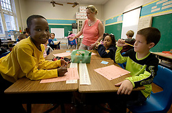 17 Jan, 2006. New Orleans, Louisiana. Post Katrina. School re-opening. 3rd grade children in class at Lusher Charter School in uptown New Orleans on their first day back since Hurricane Katrina. L/R Kieth James (8 yrs) and his friend Jonathan Sedlacek (9 yrs) work on their first day project together. The school suffered $2 million in damages and has been repaired and returned to service with the help of contractors and parents who have worked tirelessly to re-open the facility to students.<br /> Photo; Charlie Varley/varleypix.com