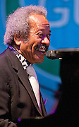 Allen Toussaint performs at the Gulf Aid Benefit Concert at Blaine Kern's Mardi Gras World