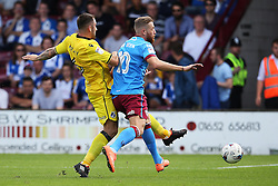 Peter Hartley of Bristol Rovers challenges Kevin van Veen of Scunthorpe United  - Mandatory by-line: Matt McNulty/JMP - 06/08/2016 - FOOTBALL - Glanford Park - Scunthorpe, England - Scunthorpe United v Bristol Rovers - Sky Bet League One