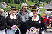 Texan and Yonderite Bill Bishop greeted a group of older women in their trachten (traditional costumes) at the Muhr prangstangen parade June 29. The tradition is observed at the height of wildflower season in the mountainous Lungau region, about an hour and a half south of Salzburg.