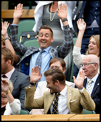 Image ©Licensed to i-Images Picture Agency. 28/06/2014, Wimbledon, London, United Kingdom. David Beckham doing the mexican wave in the Royal box on Day 6 of the Wimbledon Tennis Championship. Picture by Andrew Parsons / i-Images