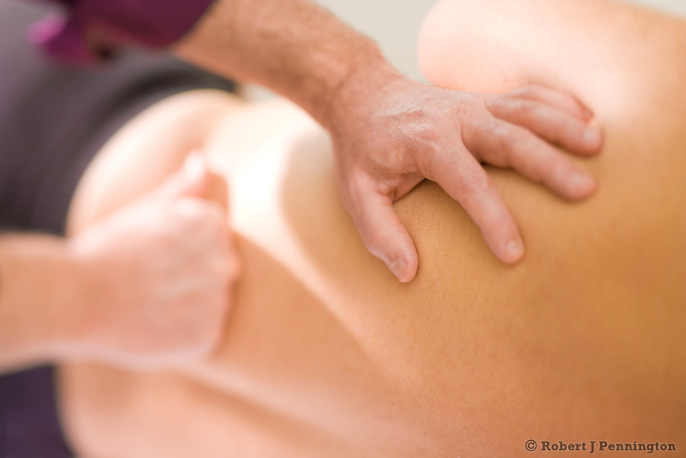 Massage Therapist Practioner and his  male patient.