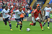 Filip Twardzik and Michail Antonio race to the ball during the Sky Bet Championship match between Bolton Wanderers and Nottingham Forest at the Macron Stadium, Bolton, England on 22 August 2015. Photo by Mark Pollitt.