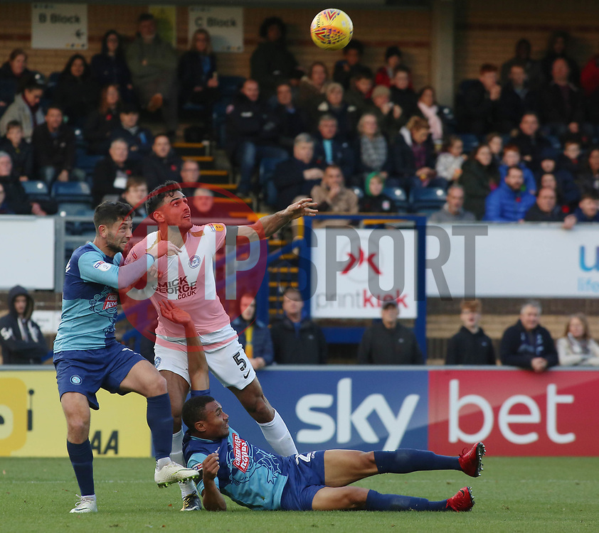 Ryan Tafazolli of Peterborough United battles for the ball with Joe Jacobson and Darius Charles of Wycombe Wanderers - Mandatory by-line: Joe Dent/JMP - 03/11/2018 - FOOTBALL - Adam's Park - High Wycombe, England - Wycombe Wanderers v Peterborough United - Sky Bet League One