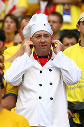 PARIS, FRANCE - WEDNESDAY, MAY 17th, 2006: An Arsenal fan with a chef's hat on during the UEFA Champions League Final at the Stade de France. (Pic by David Rawcliffe/Propaganda)