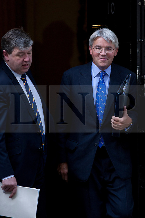 © Licensed to London News Pictures. 05/09/2012. LONDON, UK. Andrew Mitchell, the Chief Whip (R), is seen leaving Number 10 Downing Street in London today (05/09/12) after attending the first cabinet meeting after a cabinet reshuffle that took place yesterday (04/09/12).  Photo credit: Matt Cetti-Roberts/LNP