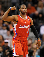 Dec. 23, 2012; Phoenix, AZ, USA; Los Angeles Clippers guard Chris Paul (3) dribbles the ball up the court during the game against the Phoenix Suns at US Airways Center. The Clippers defeated the Suns 103-77. Mandatory Credit: Jennifer Stewart-USA TODAY Sports.