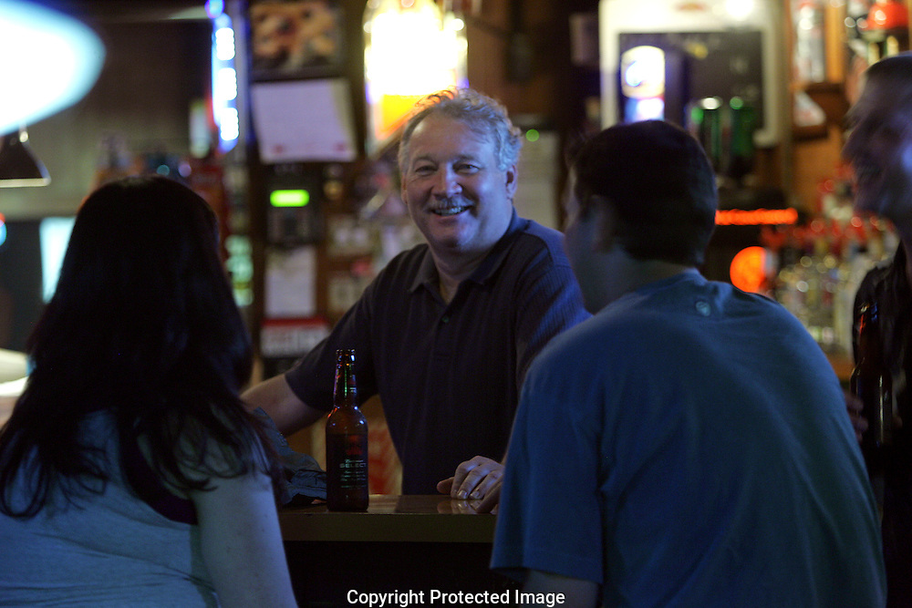 "The Library Bar owner Dave ""Cricket"" Shaw talks with customers on a recent Saturday night..(Jodi Miller/Alive)"