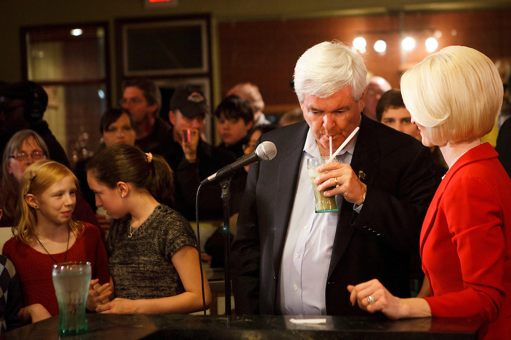 While his grandchildren, left and wife Callista Gingrich, right watch, Republican presidential candidate Newt Gingrich tries a root beer float his wife made as they campaign at the Adams Street Espresso Shop on Friday, December 30, 2011 in Creston, Iowa.
