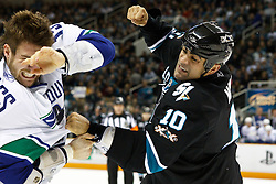 January 3, 2011; San Jose, CA, USA;  San Jose Sharks center Jamal Mayers (right) punches Vancouver Canucks center Tanner Glass (15) during the first period at HP Pavilion. Mandatory Credit: Jason O. Watson / US PRESSWIRE