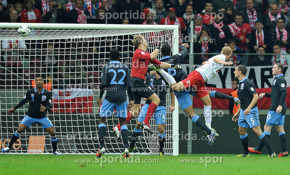 POLAND, WARSAW : Poland's Kamil Glik (2nd R) scores the equalizer during the FIFA 2014 World Cup qualifying football match Poland vs England in Warsaw on October 17, 2012..Photo by : Piotr Hawalej