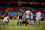 While the bulls players celebrate, Beauden Barrett, of the Hurricanes  consoles his team mate Blade Thomson, of the Hurricanes after the loss of the 2018 Super Rugby game between the Bulls and the Hurricanes at Loftus Versveld, Pretoria on 24 February 2018.<br /> Copyright photo: Catherine Kotze/BackpagePix / www.photosport.nz