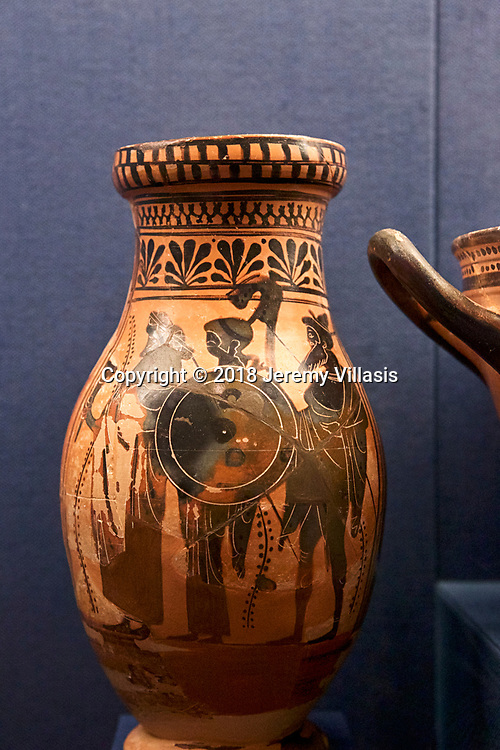Attic black-figure olpe (a type of wine jug) with a depiction of Athena, Dionysos, and Hermes. (510-500 BC)
