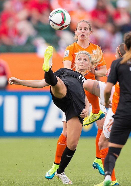 New Zealand's Katie Bowen  kicks the ball during a Group A football match against the Netherlands during the opening day of the FIFA Women World Cup at Commonwealth Stadium in Edmonton, Canada on June 6, 2015.  The Netherlands defeated the New Zealanders 1-0.   AFP PHOTO/GEOFF ROBINS