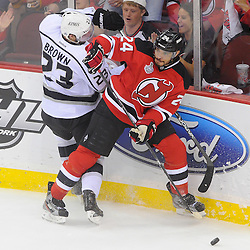 June 9, 2012: New Jersey Devils defenseman Bryce Salvador (24) blocks off Los Angeles Kings right wing Dustin Brown (23) from the puck and plays it away during first period action in game 5 of the NHL Stanley Cup Final between the New Jersey Devils and the Los Angeles Kings at the Prudential Center in Newark, N.J.