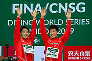 Luxian Wu of China and Zongyuan Wang of China wave to the crowd on the podium before being given their Gold Medals during the FINA/CNSG Diving World Series 2019 at London Aquatics Centre, London, United Kingdom on 17 May 2019.